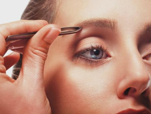 How to pull out eyebrows without pain?