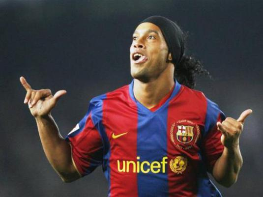 Where does Ronaldinho play?