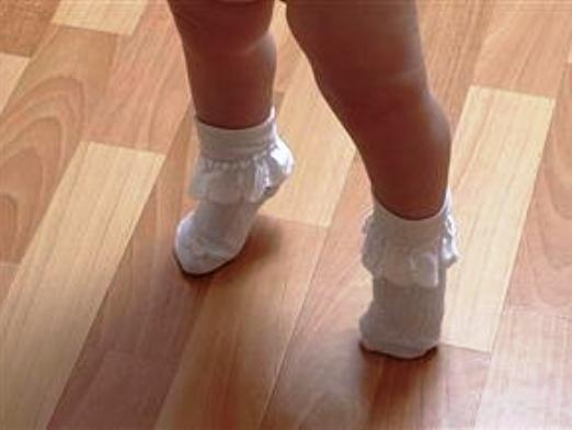 Why does a child walk on socks?