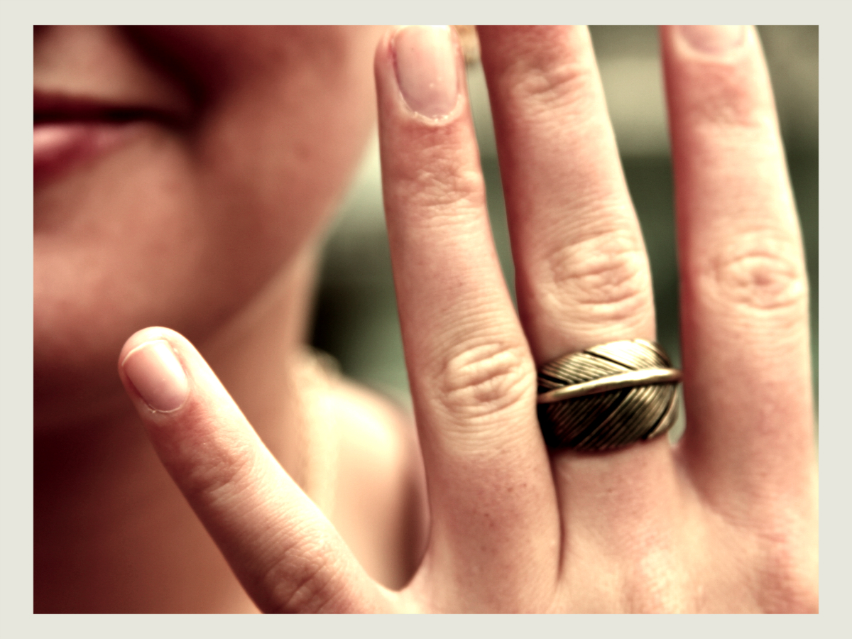 Ring on the middle finger.