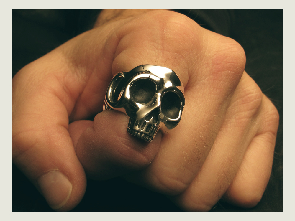 The ring on the index finger.